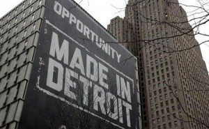 "A large ""Opportunity Made In Detroit"" banner is seen on the side of one of the buildings owned by Quicken Loans founder Gilbert in downtown Detroit"